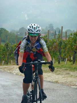 bike tours italy female biker in vineyard